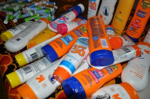 Photo of donated bottles of sunscreen and lip balm