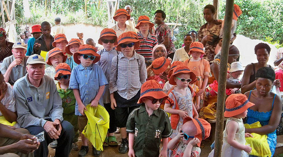 Photo of children with their rafiki packs and sun hats.
