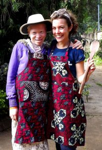 A volunteer with one of the members of the sewing cooperative caebccd2798